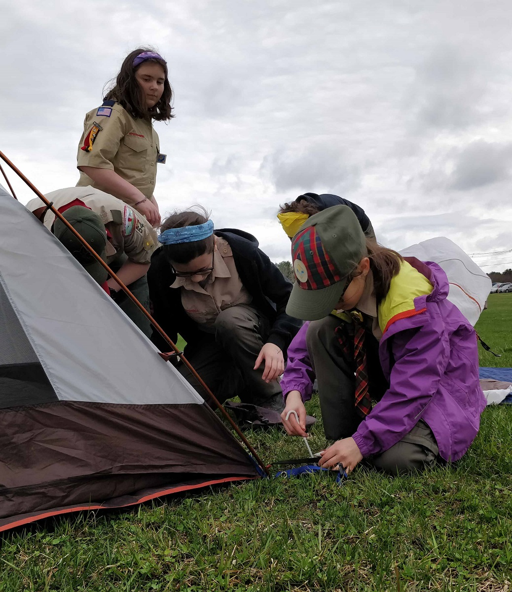 Troop 7054 and Pack 54 Scouts set up a tent at the Isaac Davis Camporee (April 2019).