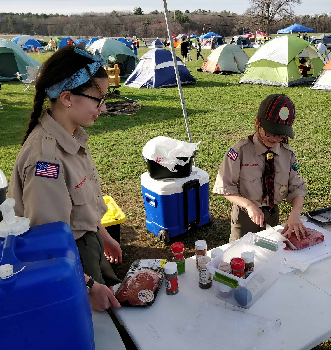 Troop 7054 and Pack 54 Scouts cook dinner at the Isaac Davis Camporee (April 2019)